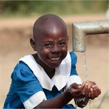 Tanzania Girl getting water