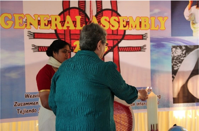 S. Mary Diez, President, lights the 2018 General Assembly candle